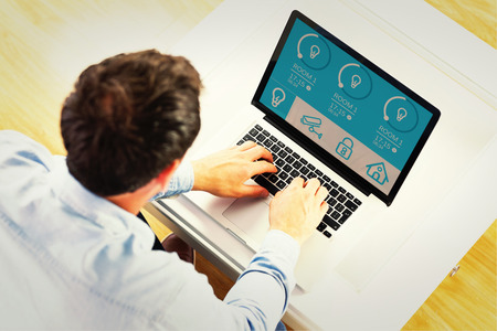 domestic room: Man using laptop against home automation system
