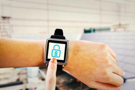 wrist: Smartwatch on wrist against workshop