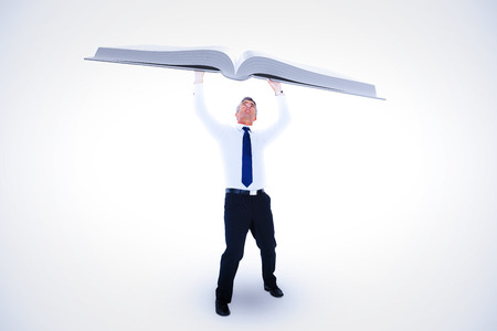 Businessman with arms up against white background with vignette