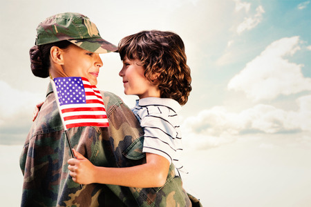 military uniform: Solider reunited with son against blue sky Stock Photo