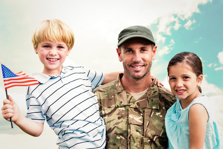 military uniform: Soldier reunited with his children against blue sky