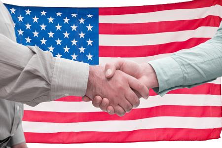 men shaking hands: Men shaking hands against grey Stock Photo