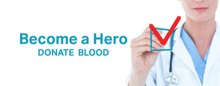 adult writing: Young doctor writing with marker against blood donation Stock Photo
