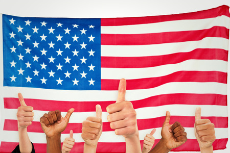 raise the white flag: Hands showing thumbs up against rippled us flag