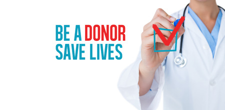 be: Doctor pointing felt pen against be a donor save lives Stock Photo