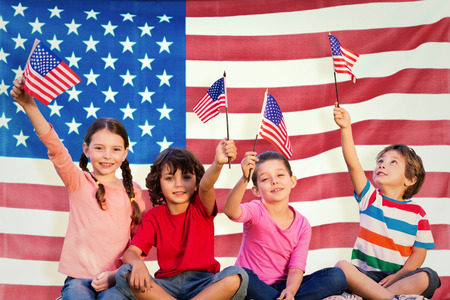 girl holding sign: Children with american flags against rippled us flag Stock Photo