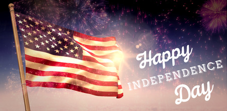 Independence day graphic against colourful fireworks exploding on black background Stock Photo