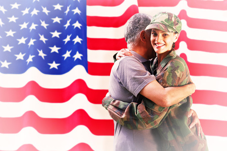 solider: Solider reunited with father against rippled us flag
