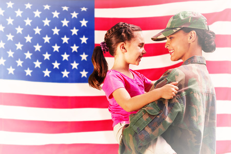 solider: Solider reunited with daughter against rippled us flag