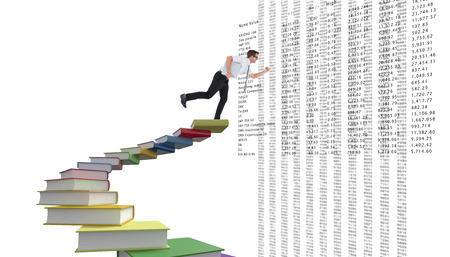 running late: Geeky businessman running late against steps made out of books