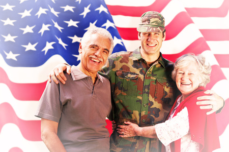 solider: Solider reunited with parents against rippled us flag