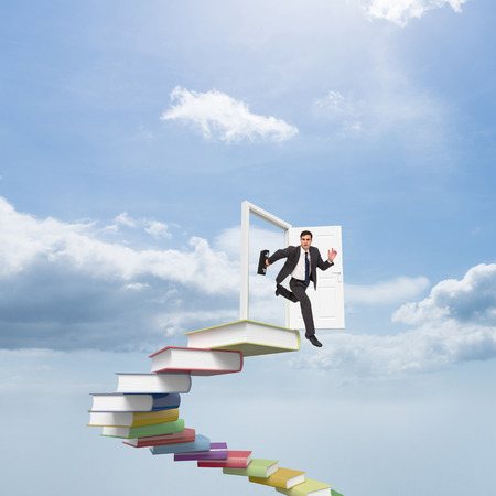 stern: Stern businessman in a hurry against blue sky