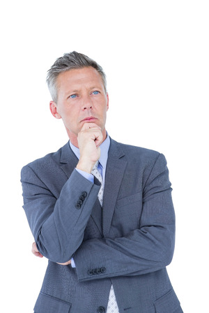 chin: Businessman thinking with hand on chin against a white background Stock Photo