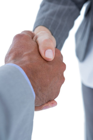 co: Businessman shaking hands with a co worker on white background
