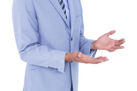 gesturing: Handsome businessman gesturing with hands on a white background