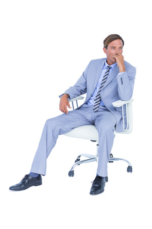 swivel: Handsome businessman sitting on a swivel chair against a white screen