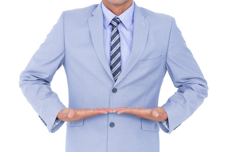 gesturing: Businessman walking while gesturing with hands on a white background Stock Photo