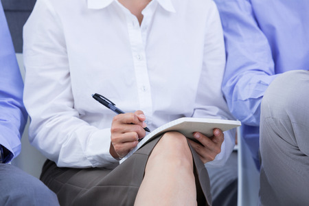 businesswomen taking a note during a meeting in the office