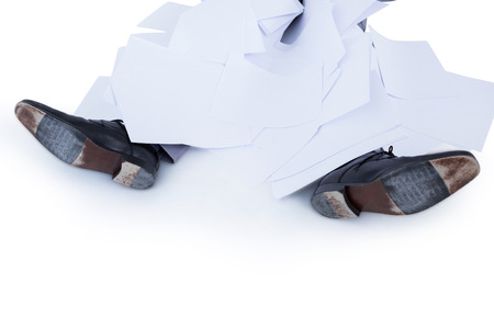 burried: businessman burried under piece of paper on white background Stock Photo