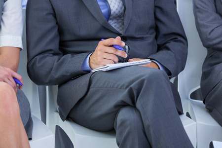businessman taking a note during a meeting in the office
