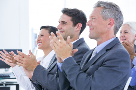 business asia: Business team applauding during conference in the office