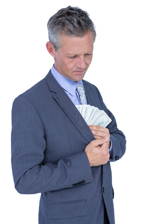 restraining device: businessman in handcuffs holding bribe on white background
