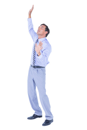 apprehensive: businessman afraid of the sky  on white background