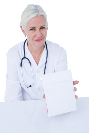 doctor writing: Doctor writing on a notepad in medical office Stock Photo