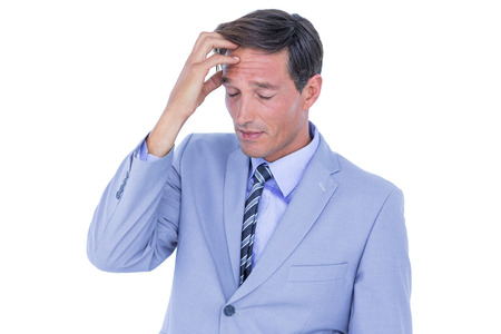 Stressed businessman getting a headache in his office