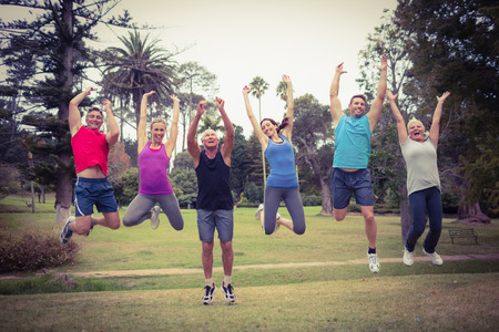 slender woman: Happy athletic jumping together on a sunny day Stock Photo