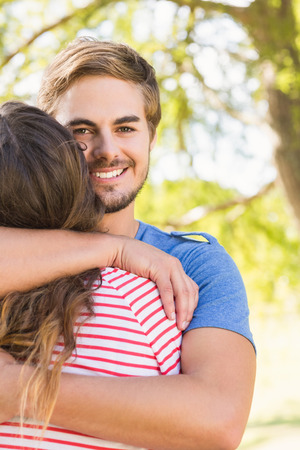 love park: Cute couple hugging in the park on a sunny day Stock Photo