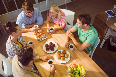 having lunch: Young business people having dessert after lunch Stock Photo