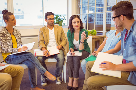Attentive creative business team in meeting at office
