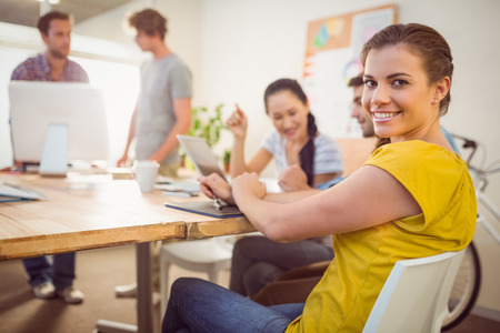 people interacting: Portrait of a smiling young businesswoman in a meeting at office