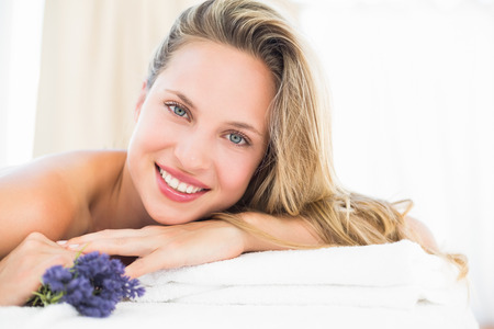 20s naked: Beautiful blonde lying on massage table with lavanda at the health spa Stock Photo