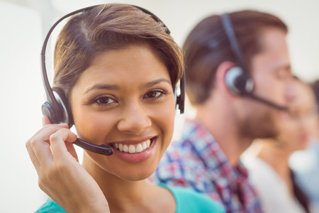 headset business: Close up plan of a smiling businesswoman in a call centre