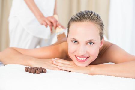 beauty treatment: Beautiful blonde enjoying a chocolate beauty treatment at the health spa
