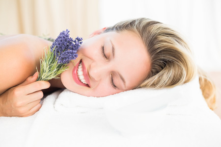 lavanda: Beautiful blonde lying on massage table with lavanda at the health spa Stock Photo