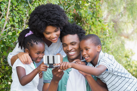 yard stick: Happy family taking a selfie in the garden at home Stock Photo