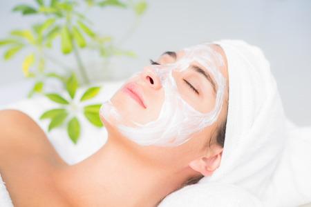 white cream: Attractive having white cream on her face at spa center