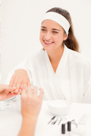 beautician: Beautiful young woman with beautician at spa beauty salon