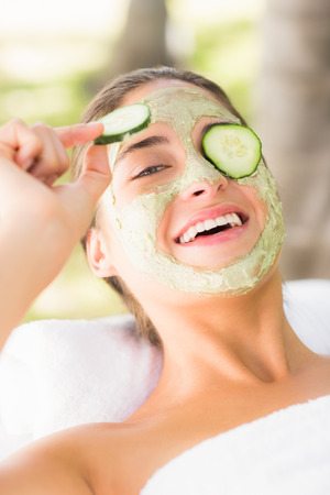 withdrawing: Pretty woman withdrawing a cucumber on her eye at the health spa Stock Photo