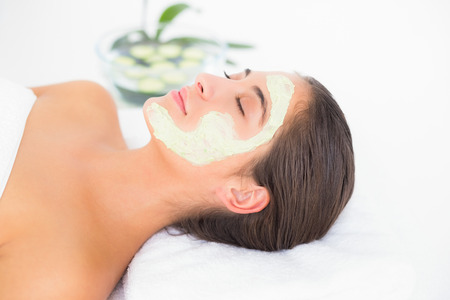 treatment: Beautiful brunette getting a facial treatment at the health spa