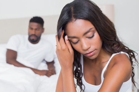 sad couple: Upset couple not talking to each other after fight at home in bedroom Stock Photo