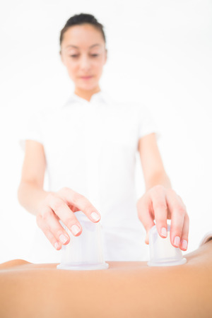 suction: Therapist making suction massage at the health spa