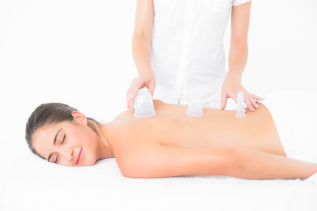 suction: Pretty woman enjoying suction massage at the health spa