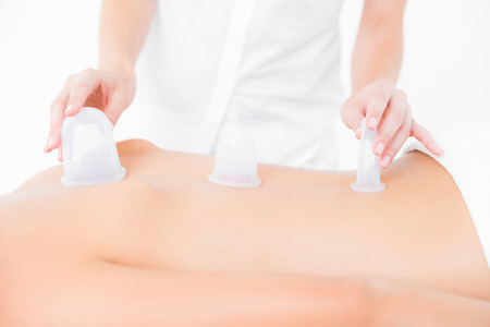 suction: Close up view of woman having a suction massage at the health spa Stock Photo