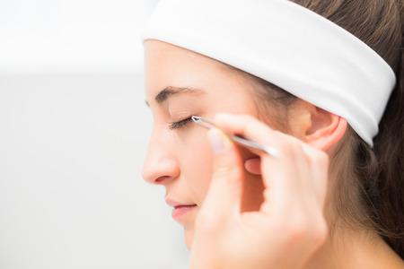eyeshadow: Close up of a hand applying eyeshadow to beautiful woman