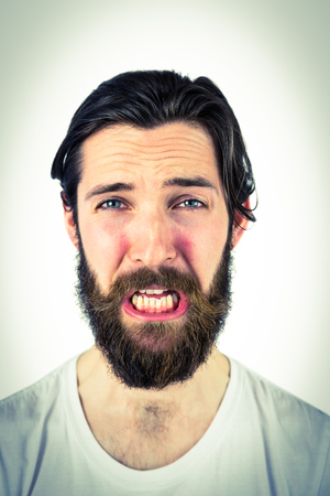 dreariness: Handsome hipster crying at camera on vignette background Stock Photo