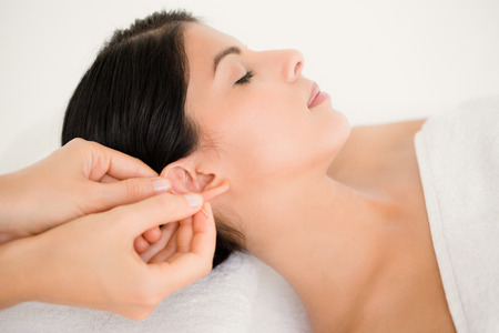 acupuncture needles: Woman in an acupuncture therapy at the health spa Stock Photo